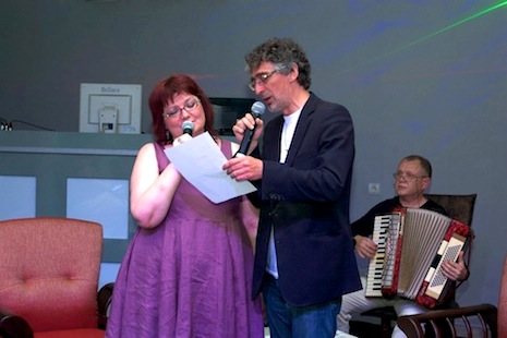 Hélène Mélat, Professor of Sorbonne University and Nikolay D. Alexandrov, literary critic, TV/radio host performing French folk songs at ARENA club