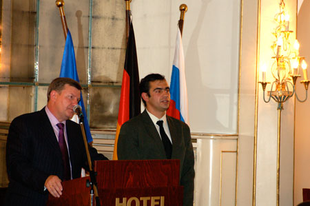 Mayor Fedyanin (left) making a speech at the exhibition inauguration, translated by Dimitri Koulitchev (right)