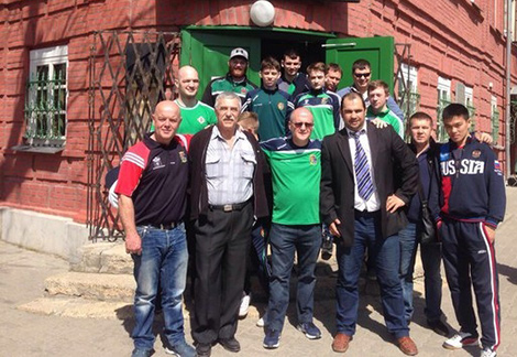 "Northern Ireland boxing team in front of ""The Chekhovs' Shop"" memorial museum"